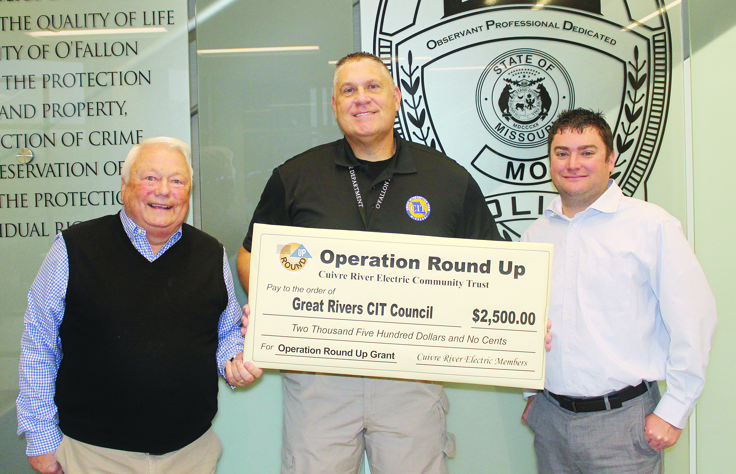 The Great Rivers Crisis Intervention Team accepts a $2,500 check from Operation Round Up